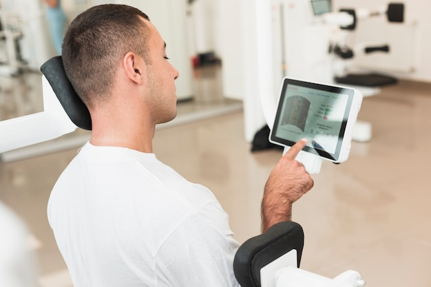 Man using tablet while training Free Photo