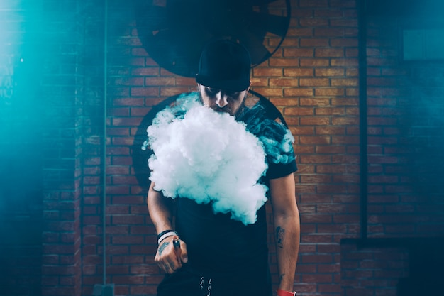 Man vaping an electronic cigarette Free Photo