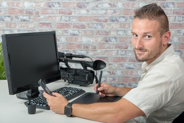 Man video editor using graphic tablet Premium Photo