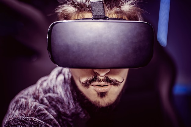 Man in virtual glasses is watching a movie in a cinema Premium Photo