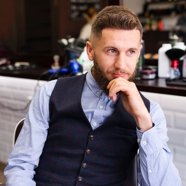 Man waiting for a new haircut Free Photo