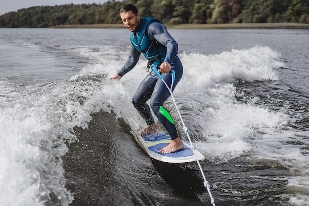 Man on wakesurfing  wave from the boat  Photo | Free Download