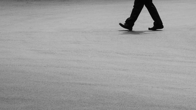 A man walking on asphalt road Premium Photo