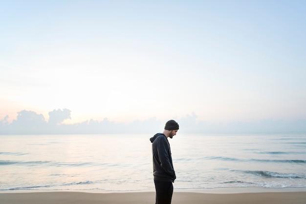 Man walking in solitude at the beach Premium Photo