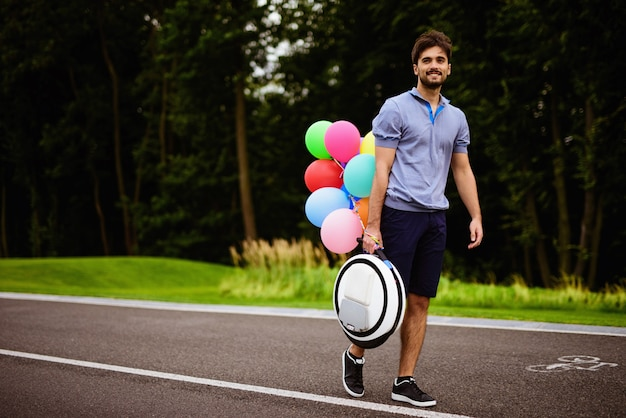 A man walks along the park path with a monocle in his hands Premium Photo