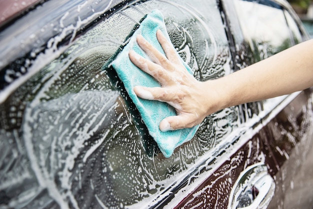 Man wash car using shampoo Free Photo