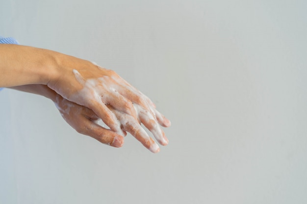 Man washing and rubbing hand to cleaning soap Premium Photo