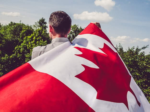 Man waving a canadian flag. national holiday Premium Photo