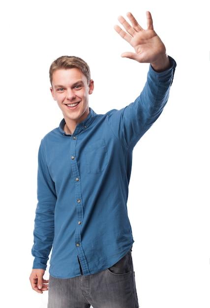 Man waving hand while smiling Photo | Free Download