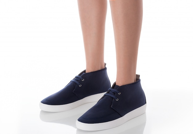 Man wearing blue fashion footwear  standing with side view isolated on white Premium Photo