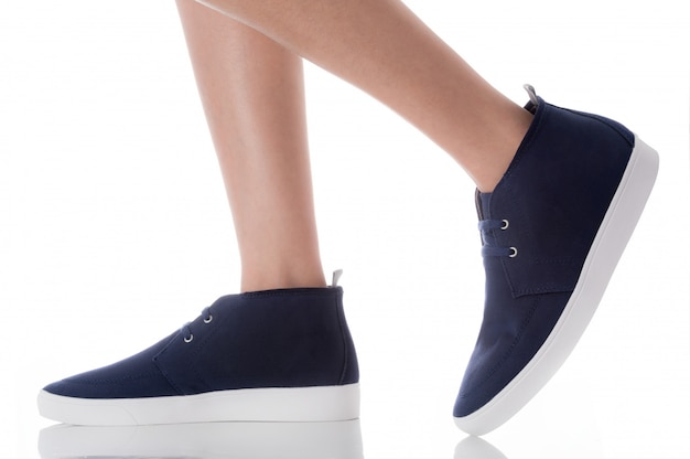 Man wearing blue fashion footwear stepping with side profile view isolated on white Premium Photo