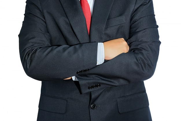 Man wearing business suit and black tie with arms crossed isolated Premium Photo