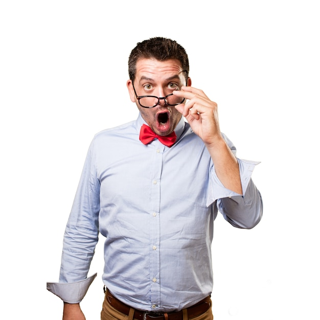 Man wearing a red bow tie. looking surprised. Free Photo