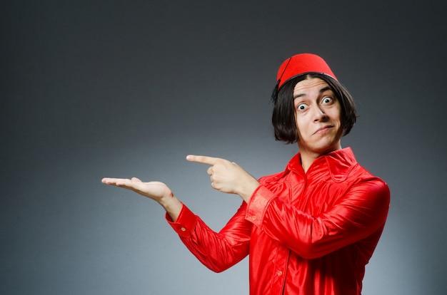 Man wearing red fez hat Premium Photo