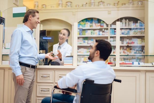 A man in a wheelchair is in a pharmacy. Premium Photo