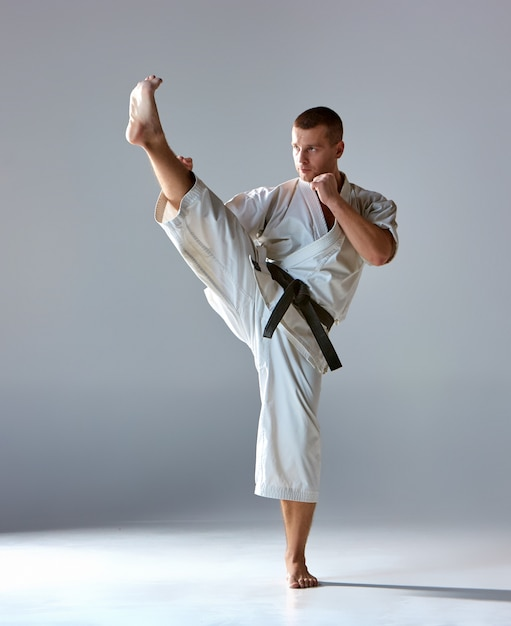 Man in white kimono training karate Free Photo