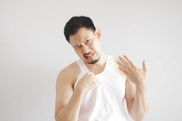 Man in white tank top with hot weather expression. concept of hot weather of the sun in asia. Premium Photo