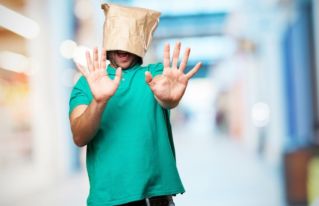 Man with a paper bag on his head Free Photo
