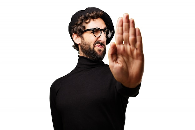 """Man with a raised hand saying """"stop"""" Photo 