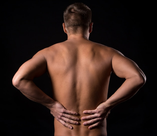 Man with back pain Free Photo