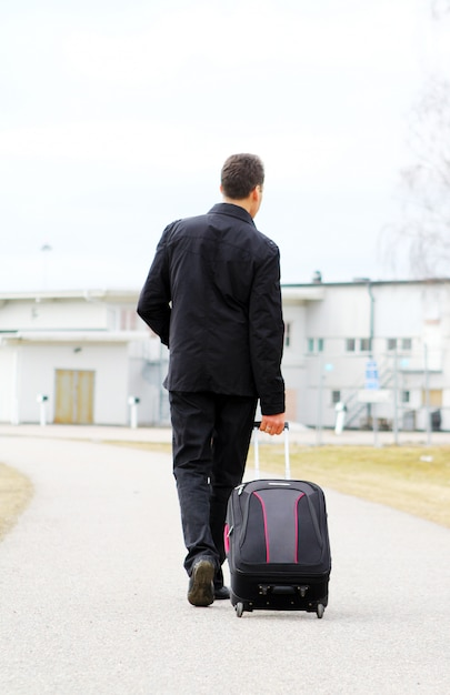 Man with baggage Free Photo
