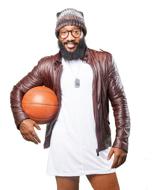 Man with a basketball in his armpit Free Photo