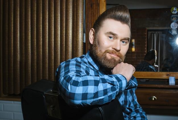 Man with a beard beautiful hair and care Premium Photo