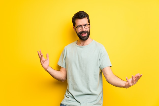 Man with beard and green shirt proud and self-satisfied in love yourself concept Premium Photo