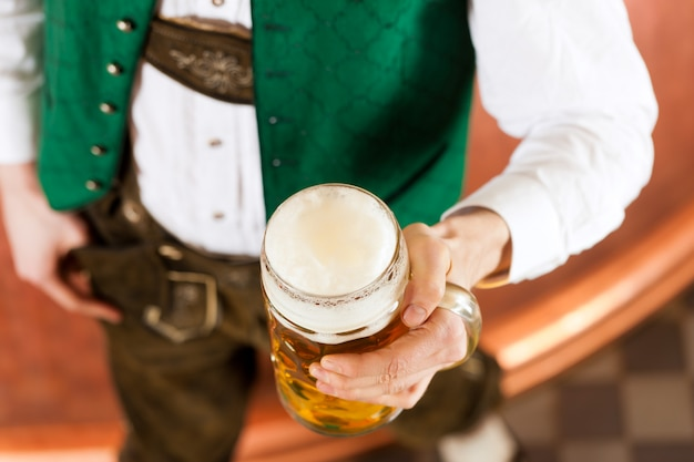 Man with beer glass in brewery Premium Photo