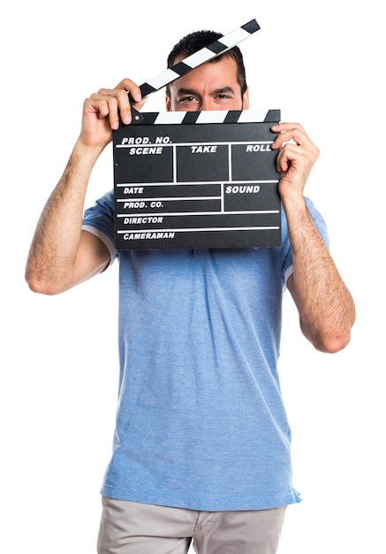 Man with blue shirt holding a clapperboard Free Photo