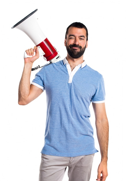 Man with blue shirt shouting by megaphone Free Photo