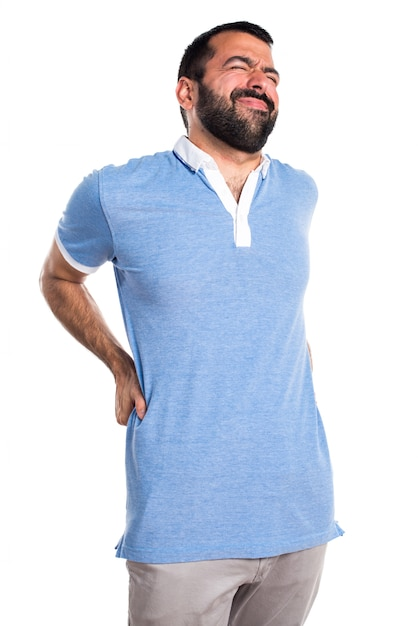 Man with blue shirt with back pain Free Photo
