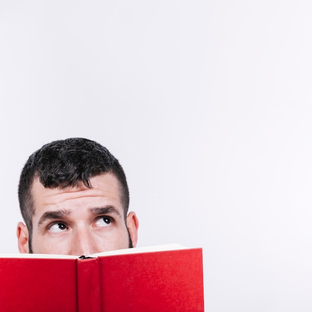 Man with book looking up 23 2147799066
