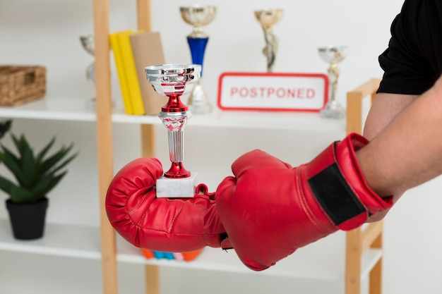 Man with box gloves holding a trophy Free Photo
