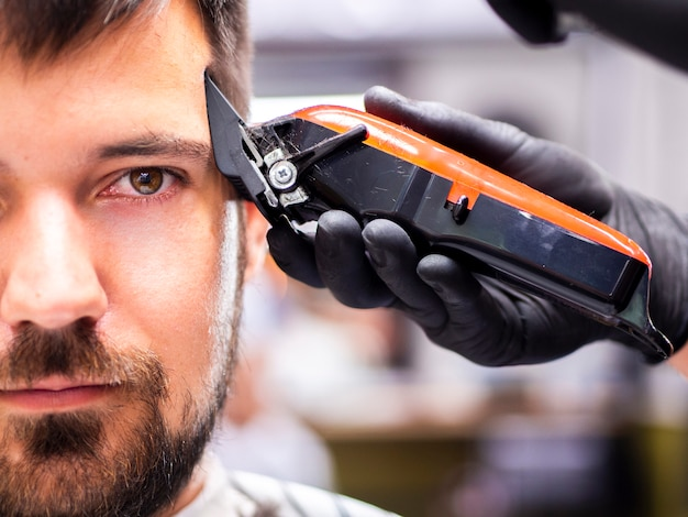 Man with brown eyes getting trimmed Free Photo