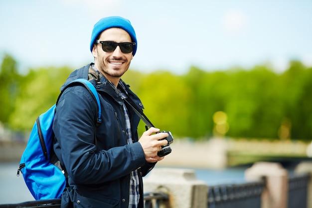 Man with camera Free Photo