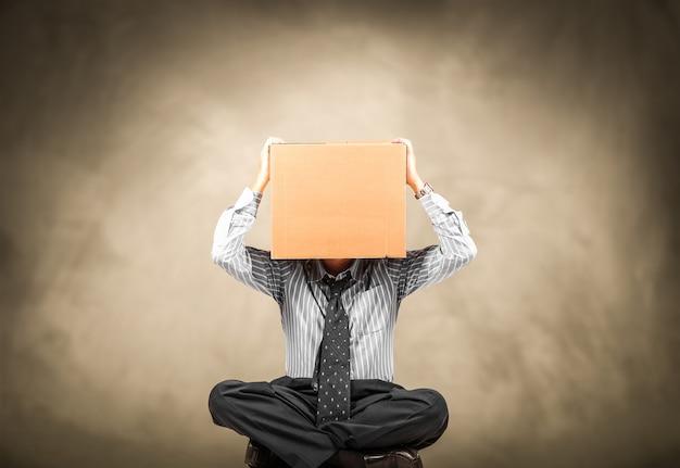 Man with a carton box on the head Premium Photo
