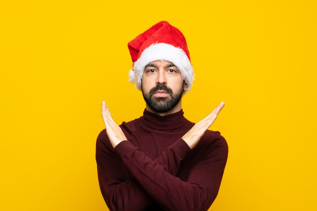 Man with christmas hat making no gesture Premium Photo