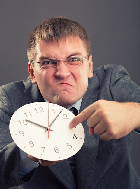 Man with clock Premium Photo
