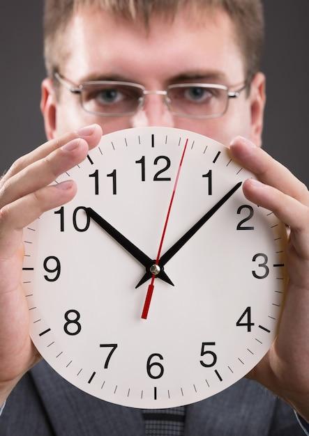 Man with clock Premium Photo