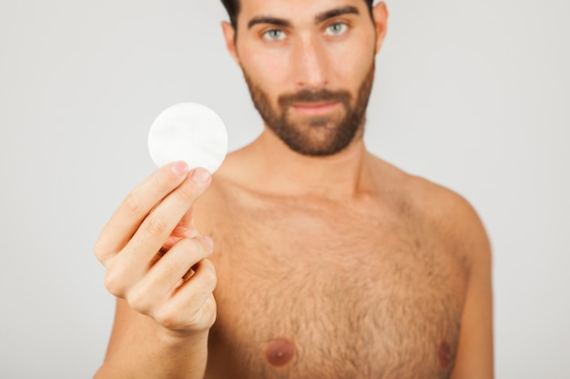 Man with cotton pad 23 2147638124