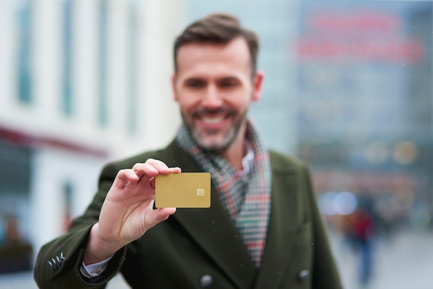 Man with credit card during big shopping Free Photo