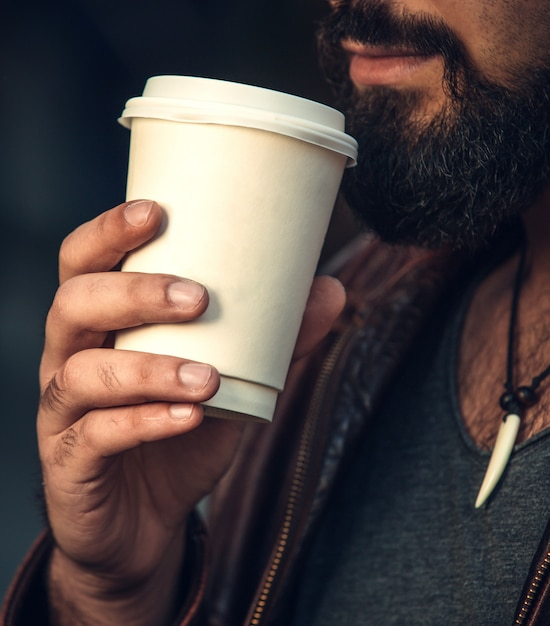 Man with a cup of coffee Free Photo