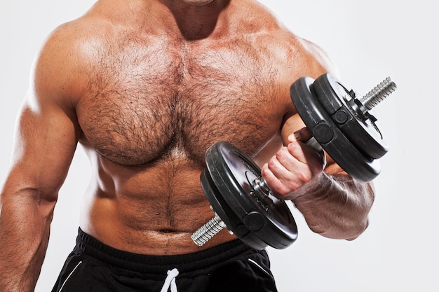 Man with dumbbell Free Photo