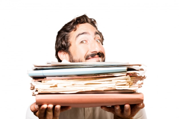 Man with a filing cabinet and a stack of papers Free Photo