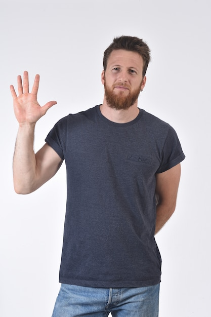 Man with finger in the shape of number five Premium Photo