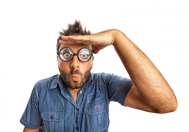 Man with funny expression and thick glasses looking far away. Premium Photo