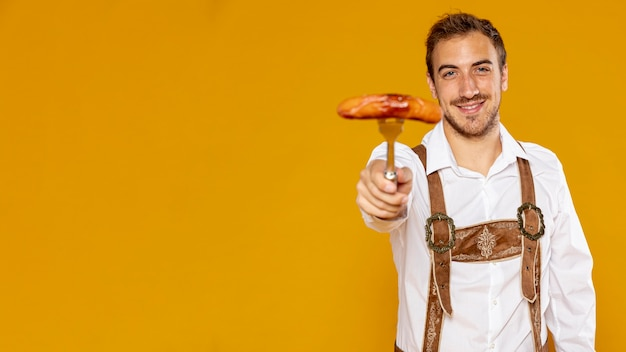 Man with german sausage and copy space Free Photo