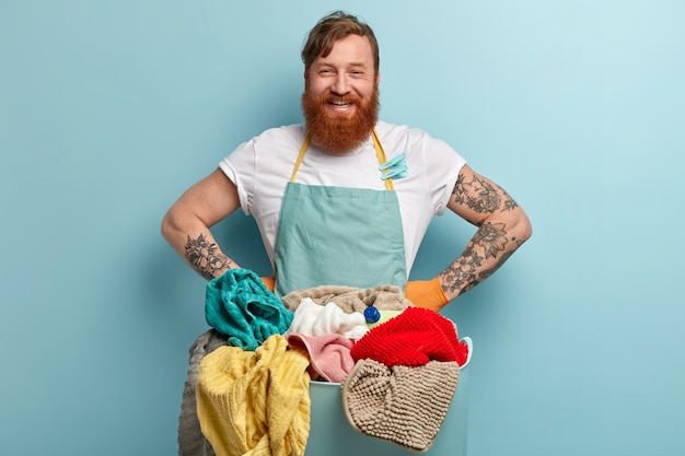 Man with ginger beard doing laundry Free Photo