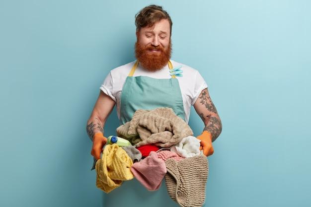 Man with ginger beard doing laundry Free Photo